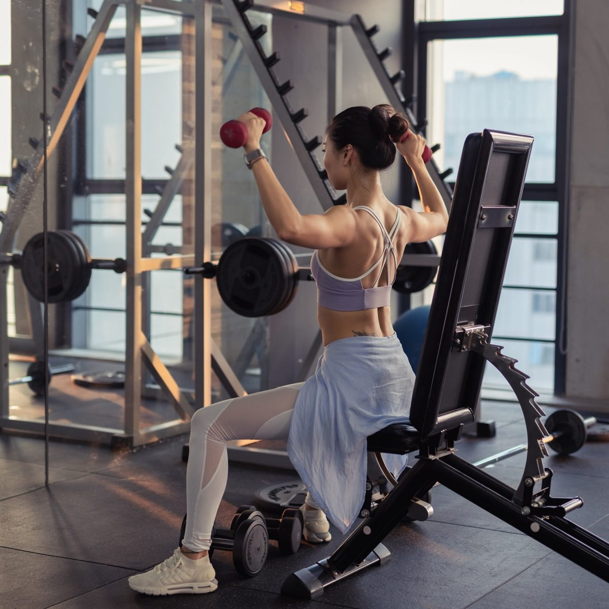 photo-of-woman-raising-dumbbells-2475878-1-1.jpg